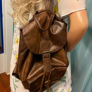 Claire's brown backpack